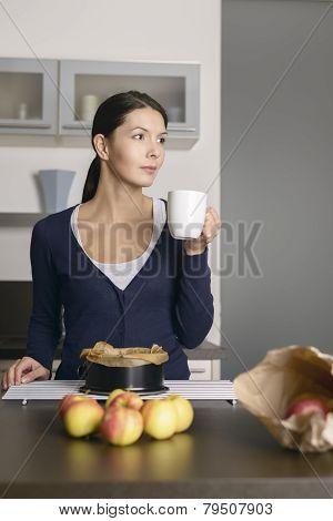Smiling Young Woman Baking Apple Tart