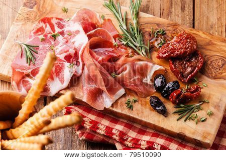 Cold Meat Plate And Bread Sticks On Wooden Background