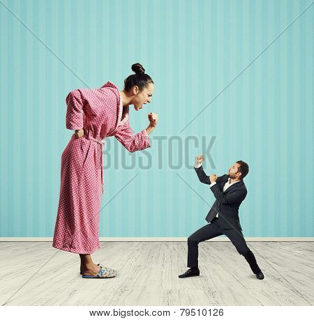 quarrel between emotional woman and small man