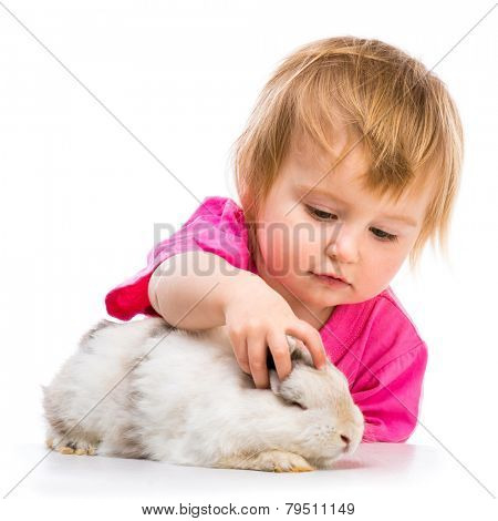 baby girl with her small white rabbit isolated on white background