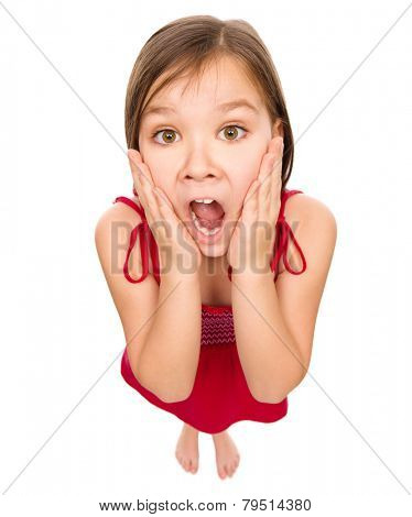 Little girl is holding her face in astonishment and looking up, fisheye portrait, isolated over white