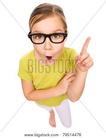 Little girl is pointing up using her index finger, idea concept, fisheye portrait, isolated over white