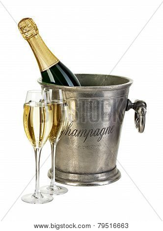 Bottle Of Champagne  In Ice Bucket With Stemware Isolated On White Background