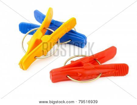Plastic clothes pegs isolated on white