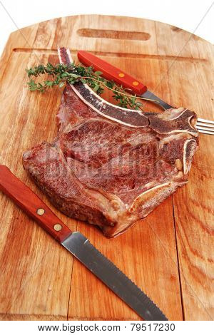 meat food : grilled beef spare rib on wooden plate with thyme
