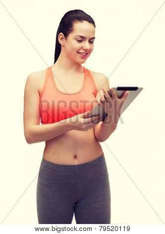 sport, excercise, technology, internet and healthcare - sporty woman with tablet pc computer