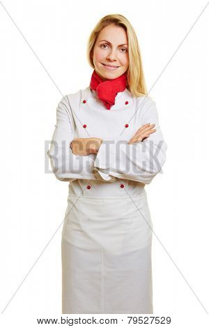 Young smiling woman as cook in apprenticeship with workwear