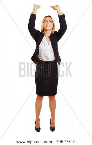 Business woman lifting imaginary object up over her head