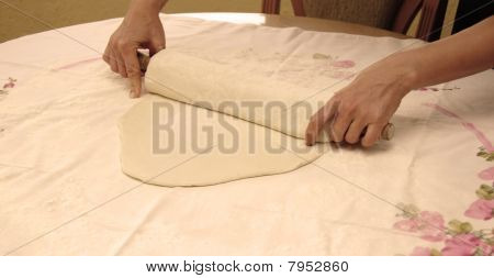 Hands With Rolling Pin Preparing Pastry