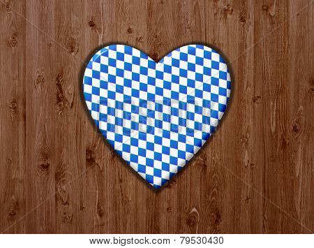 Wooden background with blue and white heart