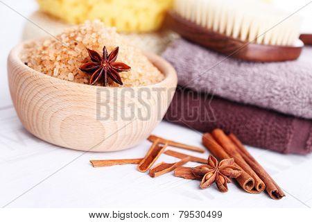 bowl of aromatic cinnamon bath salt - beauty treatment