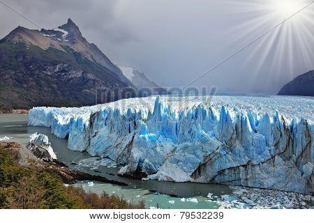 Colossal Perito Moreno glacier in Lake Argentino. Los Glaciares National Park in Patagonia. Sunny summer day
