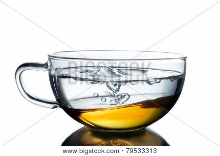 Tea and water in glass cup isolated on white