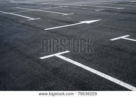 Asphalt Surface Of The Parking With Road Marking Lines