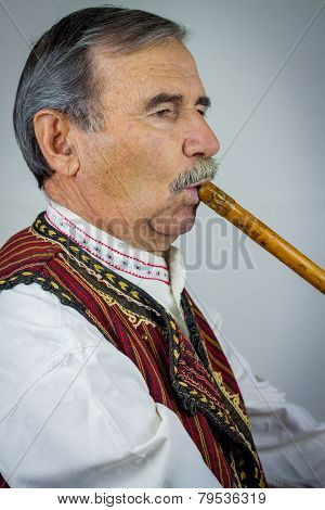 Pipe Player In Traditional Clothing