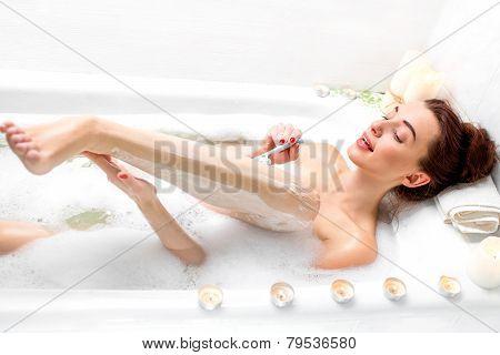 Woman shaving
