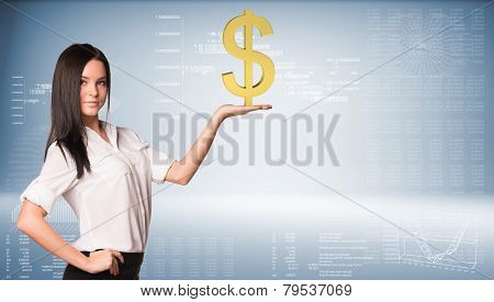 Beautiful businesswoman holding dollar sign. Blue gradient background