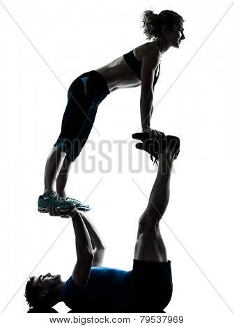 one  couple man woman personal trainer coach exercising acrobatic silhouette studio isolated on white background
