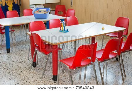 Classroom Nursery With Red Chairs And Desks