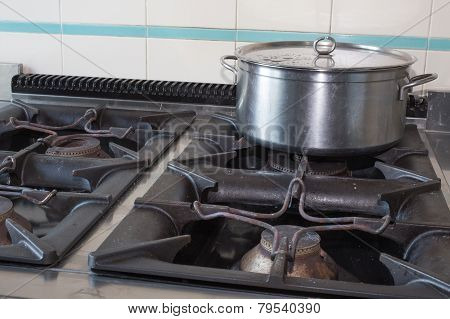 Steel Big Pot Over The Stove Of Industrial Kitchen