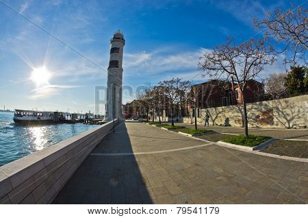 Lighthouse and pier at Murano island in Venice