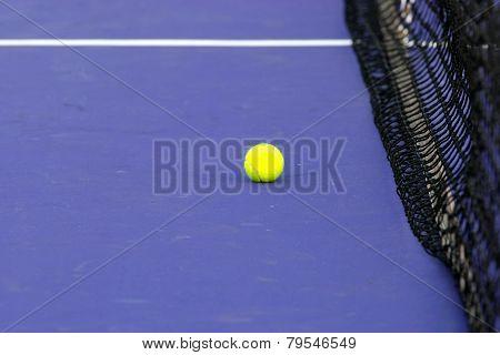 Tennis Ball & Net On Court Field