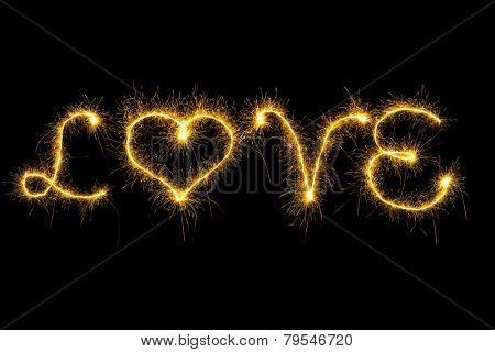 Sparking love word on black background