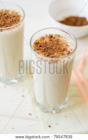 milkshake with chocolate topping in glass cup