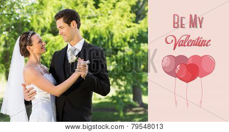 Couple dancing on wedding day against cute valentines message