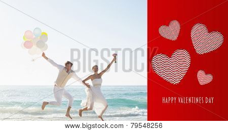 Cute valentines message against newlyweds having fun holding balloons