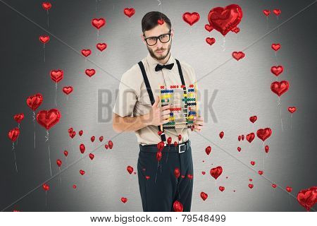 Geeky hipster holding an abacus against white background with vignette