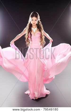 Beauty Fashion Girl Model Posing In Blowing Transparent Chiffon Dress With Voluminous Skirt Over Dar