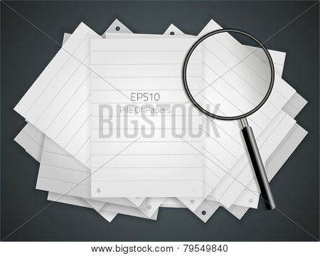Pile of papers and a magnifying glass.