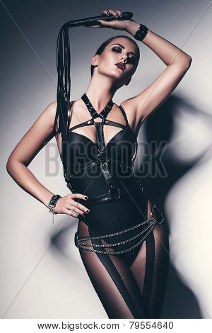 Hot Woman In Black Corset With Whip
