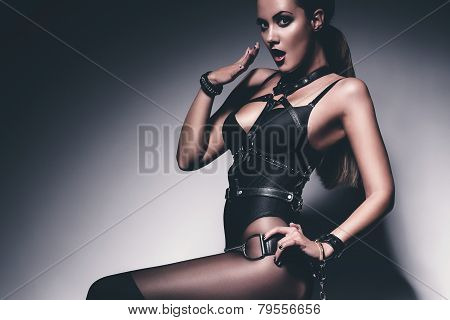 Surprised Woman In Black Corset