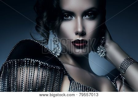 Cold Elegant Woman In Accessories Of Stones
