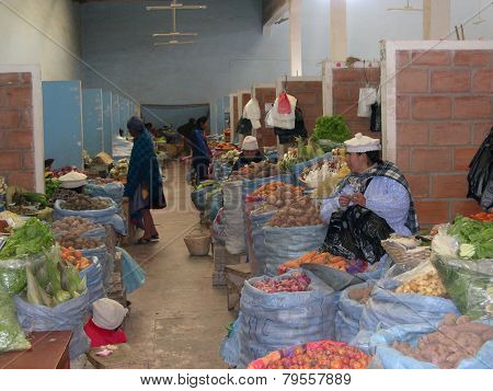 Women Shopping In A Vegetable Market In Uyuni; Bolivia