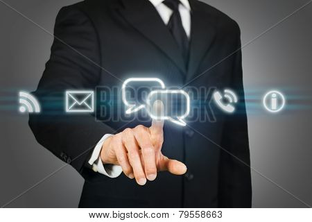 Businessman Clicking On Live Chat Icon