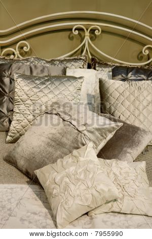 satin cushions on a bed