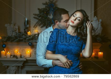 Man Passionately Kissing The Woman's Neck.