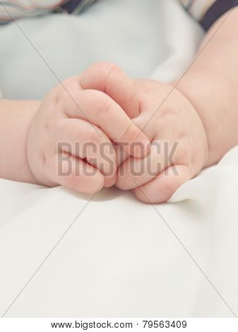 Hands of a small child.