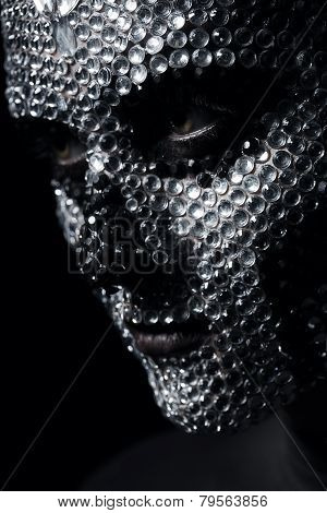 Serious Woman With Rhinestone Skull On Face