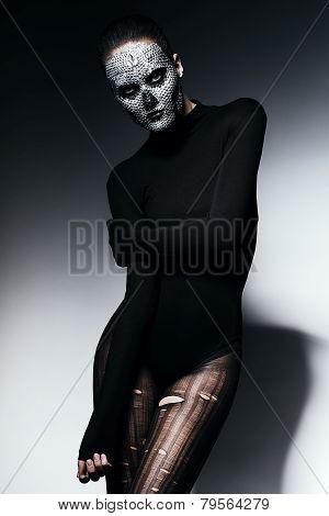 Woman In Black Torn Pantyhose