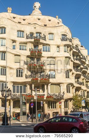 BARCELONA, SPAIN - DEC 24, 2014: Casa Mila (La Pedrera) - apartment house, built in the years 1906-1910 architect Antoni Gaudi­ for the Mila family, one of the attractions of the Catalan capital.