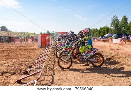 Motocrossers In The Starting Line Waiting For Race To Start