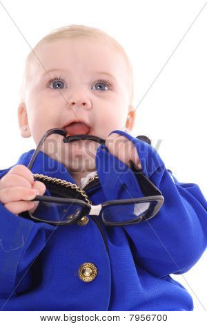 baby holding genius glasses
