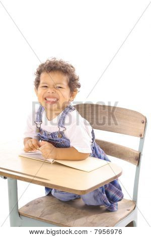 funny face toddler in a desk