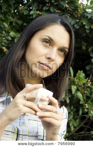 Teen drinking coffee