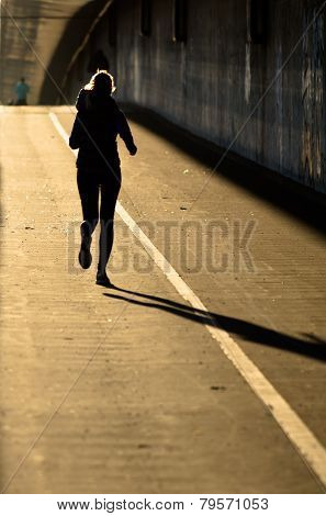 Single Female Jogger In Backlight