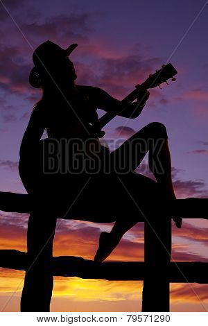 Silhouette Of A Woman With A Guitar Playing